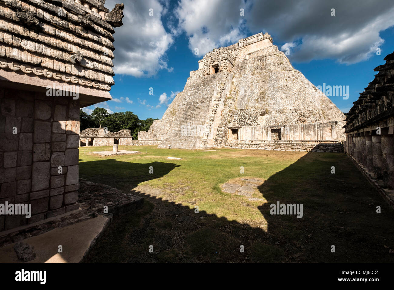 Uxmal, Yucatan, Mexico - October 13, 2017: The Pyramid of the Magician (Pirámide del Mago) towering in the Maya City of Uxmal, Mexico Stock Photo