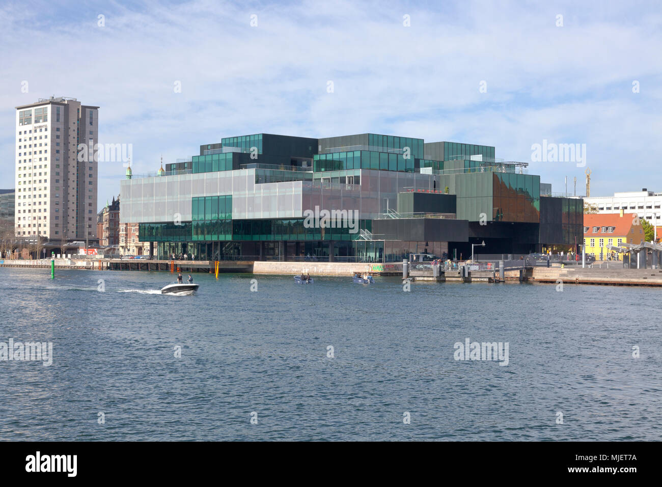 Copenhagen, Denmark. 5th May, 2018. The BLOX building, a new prestige building for architecture and design at the waterfront at Frederiksholm Canal next to the Black Diamond in the inner harbour. The building houses the Danish Architecture Centre and a number of companies working with future solutions for cities. The building was inaugurated by H.M. Queen Margrethe II yesterday - today open house to a festive opening day. BLOX is the original name of the old brew-house property where it is situated. Credit: Niels Quist/Alamy Live News - Stock Image