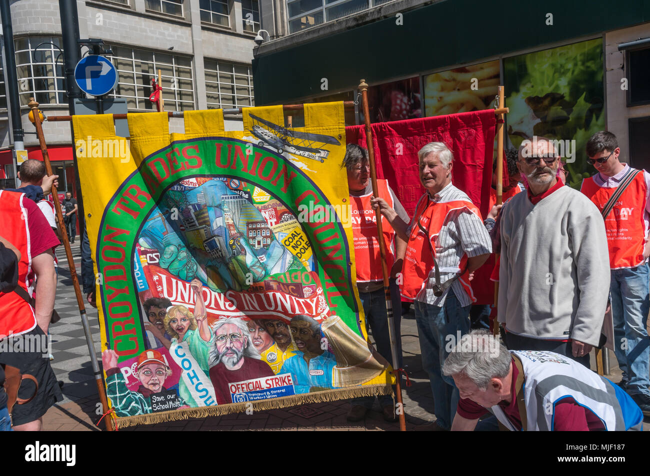 London, UK. 5th March 2018. Trade unionists and other socialists meet in Croydon to march through the city centre to a rally at Ruskin House in celebration of May Day, International Workers Day which is celebrated internationally on May 1st.  Unfortunately May Day is not a Bank Holiday in the UK. The marchers were lead through the main shopping street by a piper and drummer in full Scots dress, attracting the attention of shoppers and others on the busy street. I left the march before it reached Ruskin House where there was to be a rally with speakers including Ted Knight. Peter Marshall/Alamy - Stock Image