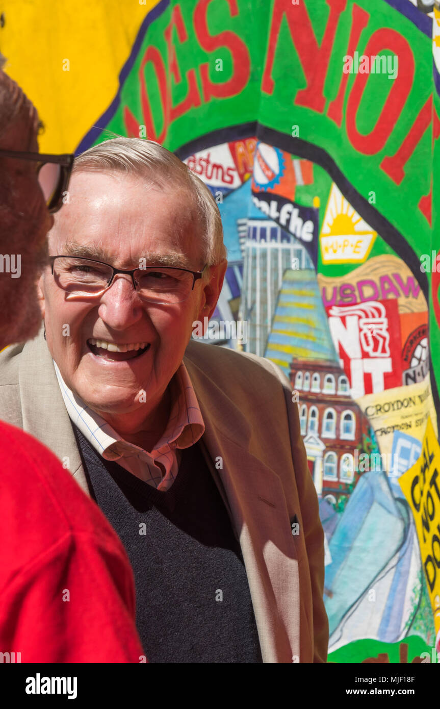 London, UK. 5th March 2018. Trade unionists and other socialists including Ted Knight, leader of Lambeth Council from 1978 until he was banned from office after the rebellion against the 1984 Rates Act, meet in Croydon to march through the city centre to a rally at Ruskin House in celebration of May Day, International Workers Day which is celebrated internationally on May 1st.  Unfortunately May Day is not a Bank Holiday in the UK. The marchers were lead through the main shopping street by a piper and drummer in full Scots dress, attracting the attention of shoppers and others on the busy stre - Stock Image