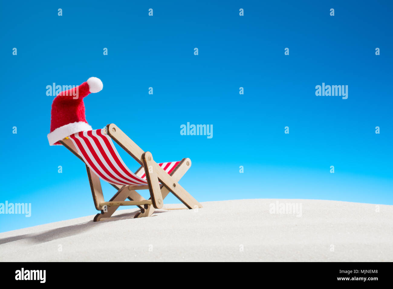 christmas on the beach a lounge chair with a santa hat