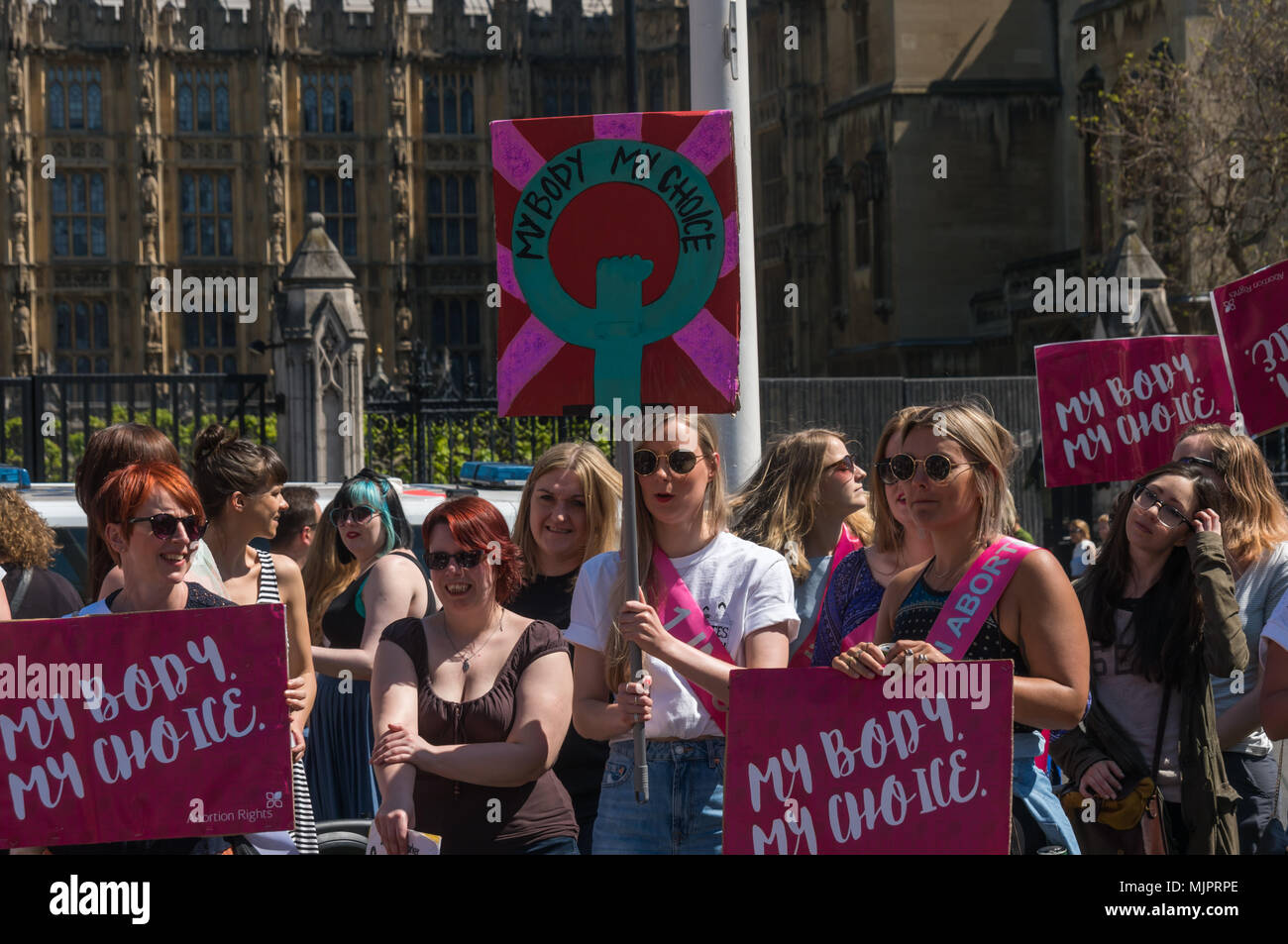 London, UK. 5th May 2018. Women in the abortion rights campaign hold posters and a placard 'My Body My Choice' at a rally in Parliament Square before the annual March for Life UK by pro-life anti-abortion campaigners was to march to a rally there. They insisted on the right for women to choose and opposed to any increase of restrictions which would lead to the problems we saw before the 1967 Abortion Act, when women risked their lives in back street abortions. They called for women in Northern Ireland to be given the same rights as in the rest of the UK and for an end of the harassment of wome - Stock Image