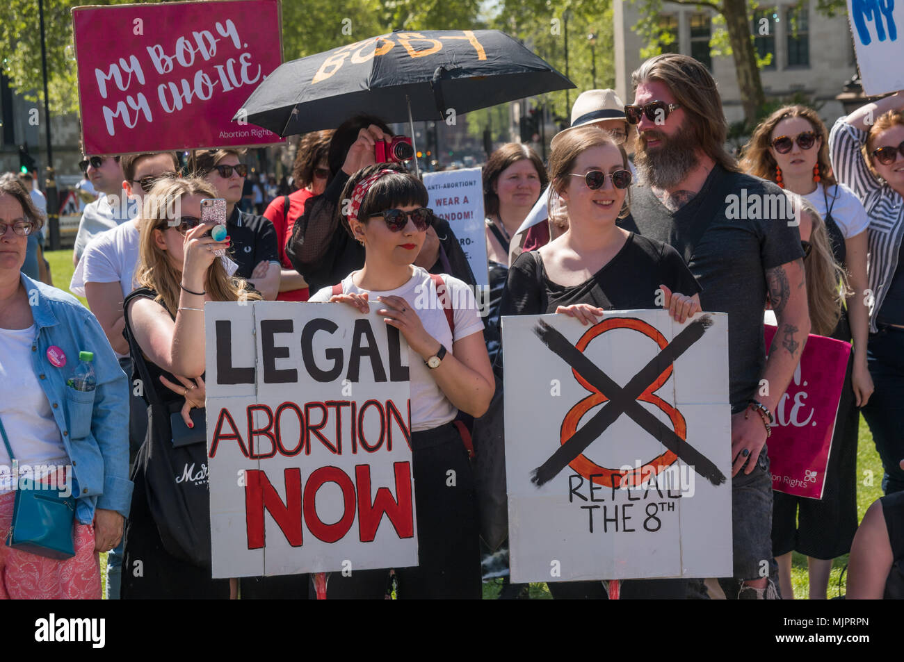 London, UK. 5th May 2018. Women in the abortion rights campaign hold posters calling for the repeal of the Irish 8th amendment against abortion at a rally in Parliament Square before the annual March for Life UK by pro-life anti-abortion campaigners was to march to a rally there. They insisted on the right for women to choose and opposed to any increase of restrictions which would lead to the problems we saw before the 1967 Abortion Act, when women risked their lives in back street abortions. They called for an end of the harassment of women going into clinics, and for women in Northern Irelan - Stock Image