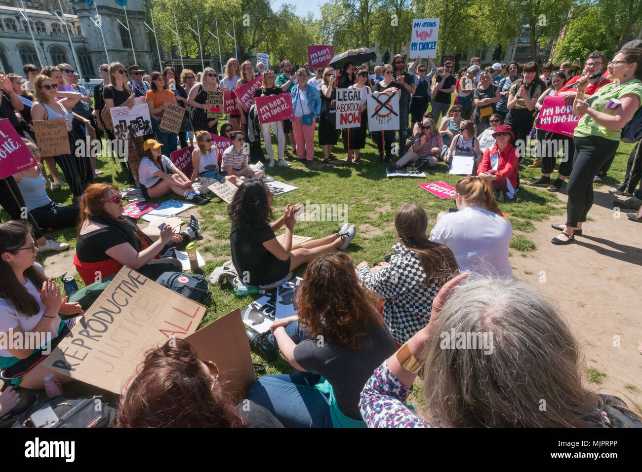 London, UK. 5th May 2018. Women in the abortion rights campaign hold a rally in Parliament Square before the annual March for Life UK by pro-life anti-abortion campaigners was to march to a rally there. They insisted on the right for women to choose and opposed to any increase of restrictions which would lead to the problems we saw before the 1967 Abortion Act, when women risked their lives in back street abortions. They called for women in Northern Ireland to be given the same rights as in the rest of the UK and for an end of the harassment of women going into clinics, and supported the Irish - Stock Image