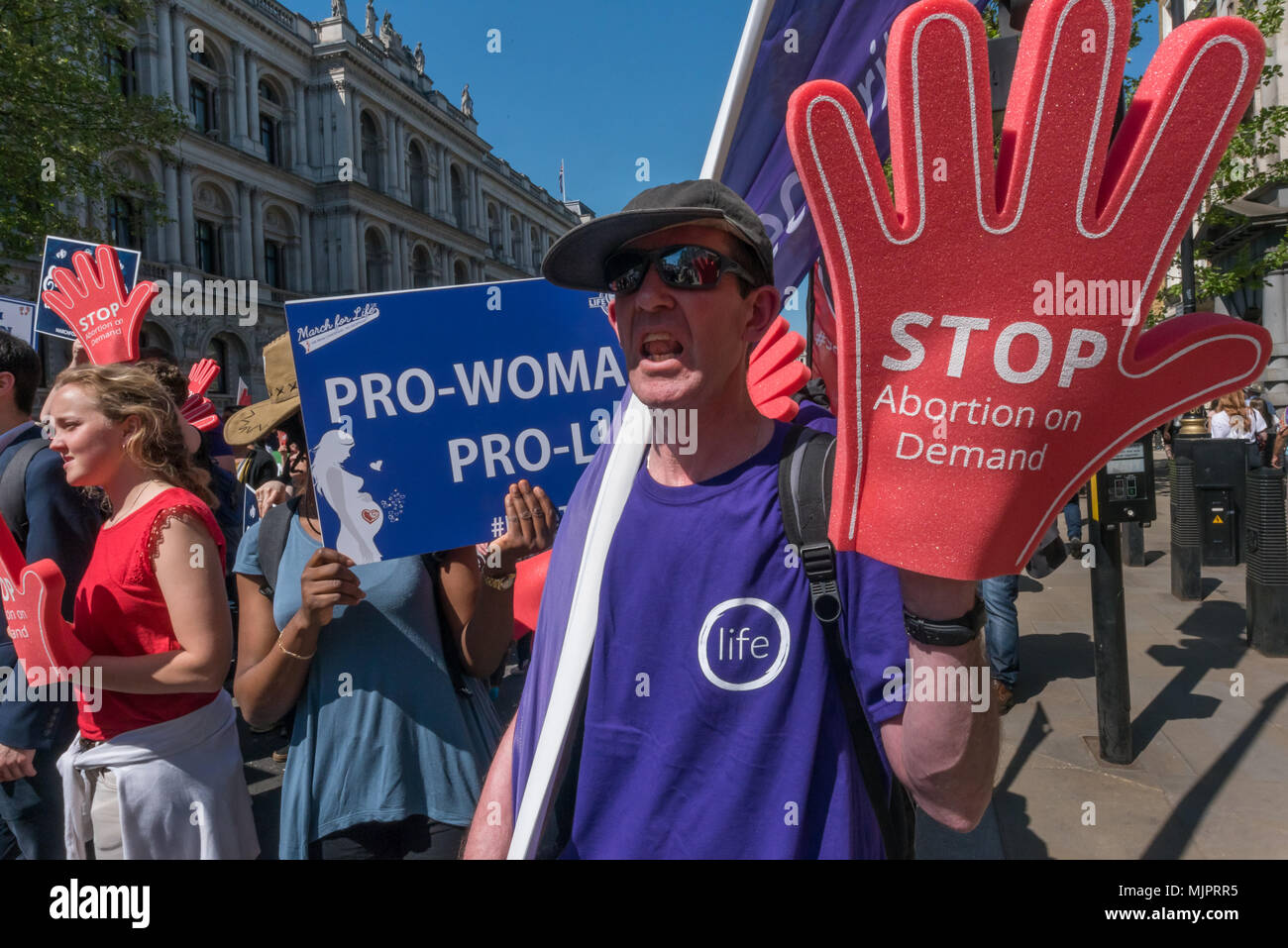 London, UK. 5th May 2018. The March for Life UK, a largely Catholic event calling for an end to abortions marches down Whitehall to a rally in Parliament Square. Opposed to abortion they aim to raise awareness of the hurt and damage that abortion causes and to unite all the pro-life groups in the UK to help bring to an end what it calls the greatest violation to human rights in history. Credit: Peter Marshall/Alamy Live News - Stock Image