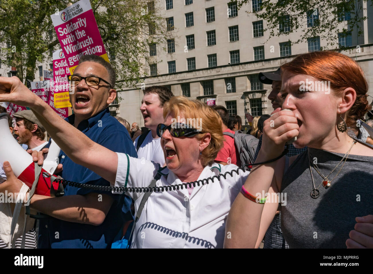 London, UK. 5th May 2018. People shout for women to have the choice to have an abortion at the March for Life UK, a largely Catholic event calling for an end to abortions as it marches down Whitehall to a rally in Parliament Square. Opposed to abortion they aim to raise awareness of the hurt and damage that abortion causes and to unite all the pro-life groups in the UK to help bring to an end what it calls the greatest violation to human rights in history. Credit: Peter Marshall/Alamy Live News - Stock Image