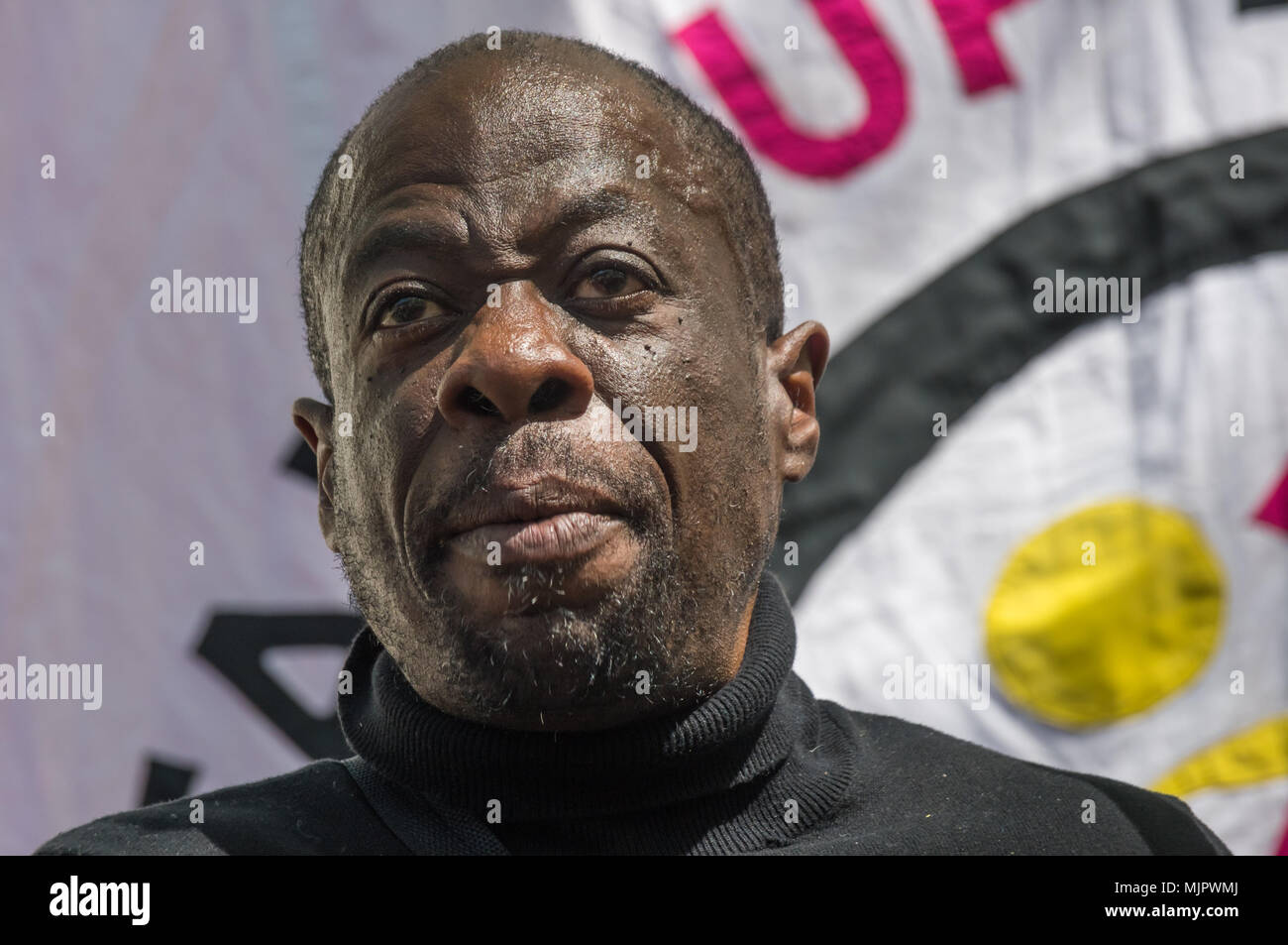 London, UK. 5th May 2018. Weyman Bennett at the Stand Up To Racism rally at Downing St calling for Theresa May's racist 2014 Immigration Act to be repealed and an immediate end to the deportation and detention of Commonwealth citizens, with those already deported to be bought back to the UK. The protesters called for protection to the guaranteed for all Commonwealth citizens and for those affected to be compensated for deportation, threats of deportation, detention, loss of housing, jobs, benefits and denial of NHS treatment. There should be an end to the 'hostile environment' for all immigran - Stock Image