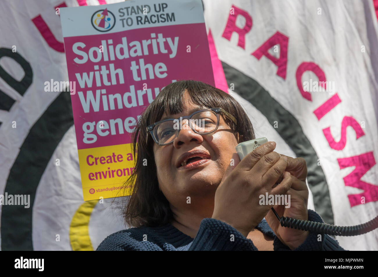 London, UK. 5th May 2018. Daine Abbott speaks at the Stand Up To Racism rally at Downing St calling for Theresa May's racist 2014 Immigration Act to be repealed and an immediate end to the deportation and detention of Commonwealth citizens, with those already deported to be bought back to the UK. The protesters called for protection to the guaranteed for all Commonwealth citizens and for those affected to be compensated for deportation, threats of deportation, detention, loss of housing, jobs, benefits and denial of NHS treatment. There should be an end to the 'hostile environment' for all imm - Stock Image