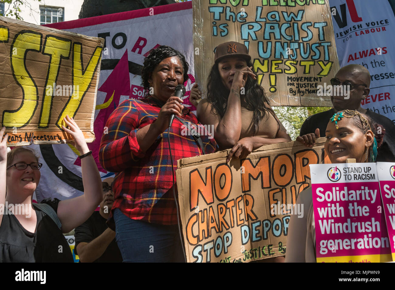 London, UK. 5th May 2018. Movement for Justice came with two women who had been held in Yarls Wood, Yvonne Williams, the daughter of a WIndrush migrant and Simone Bailey, to speak at the Stand Up To Racism rally at Downing St calling for Theresa May's racist 2014 Immigration Act to be repealed and an immediate end to the deportation and detention of Commonwealth citizens, with those already deported to be bought back to the UK. The protesters called for protection to the guaranteed for all Commonwealth citizens and for those affected to be compensated for deportation, threats of deportation, d - Stock Image