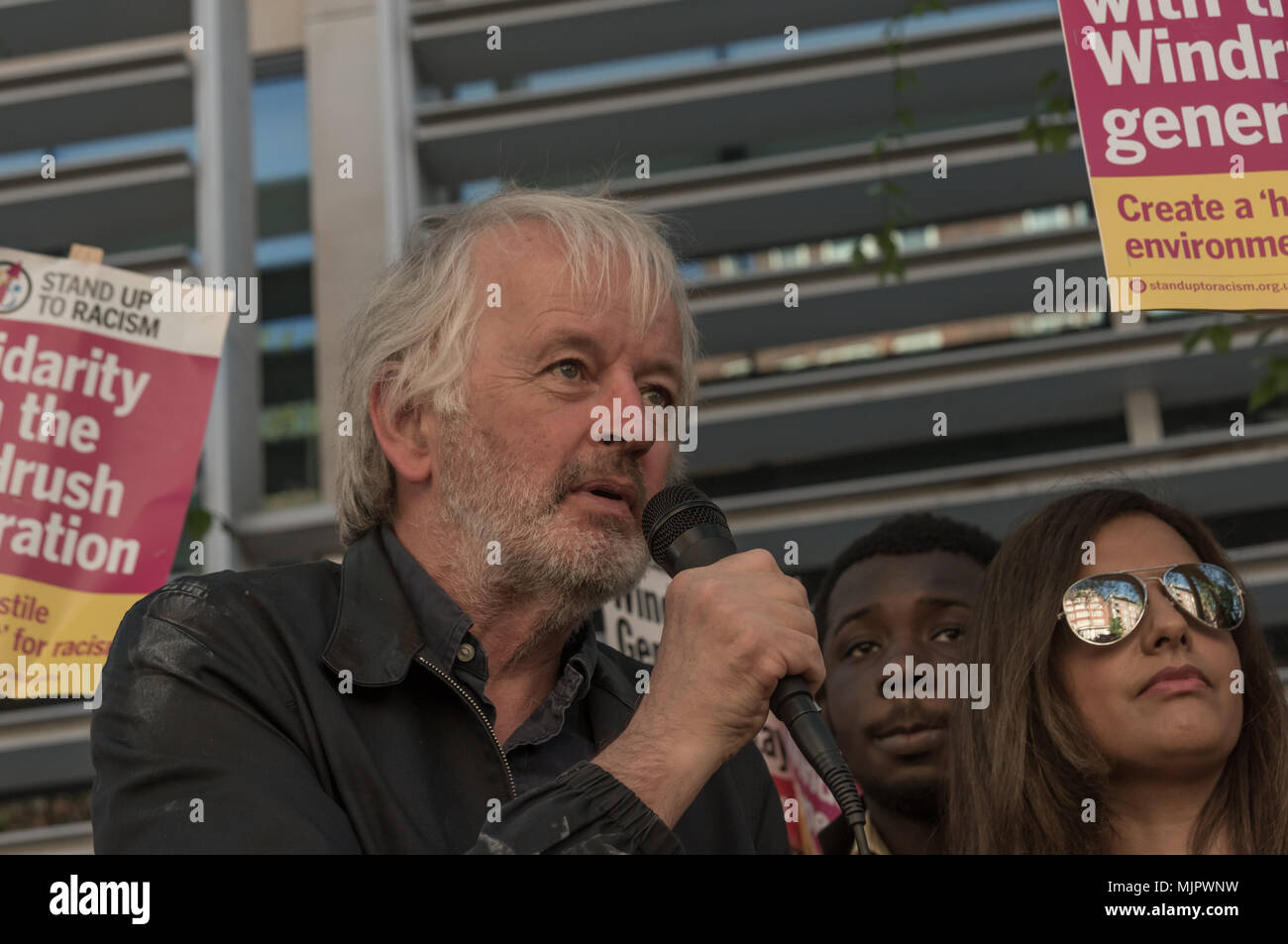 London, UK. 5th May 2018. Steve Hart, Unite Against Fascism speaks at the protest outside the Home Office calling for Theresa May's racist 2014 Immigration Act to be repealed and an immediate end to the deportation and detention of Commonwealth citizens, with those already deported to be bought back to the UK. There should be an end to the 'hostile environment' for all Credit: Peter Marshall/Alamy Live News - Stock Image
