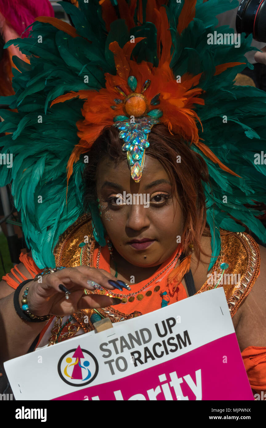 London, UK. 5th May 2018. One of several women who  came in carnival costumes for the rally at Downing St and protest outside the Home Office calling for Theresa May's racist 2014 Immigration Act to be repealed and an immediate end to the deportation and detention of Commonwealth citizens, with those already deported to be bought back to the UK. There should be an end Credit: Peter Marshall/Alamy Live News - Stock Image