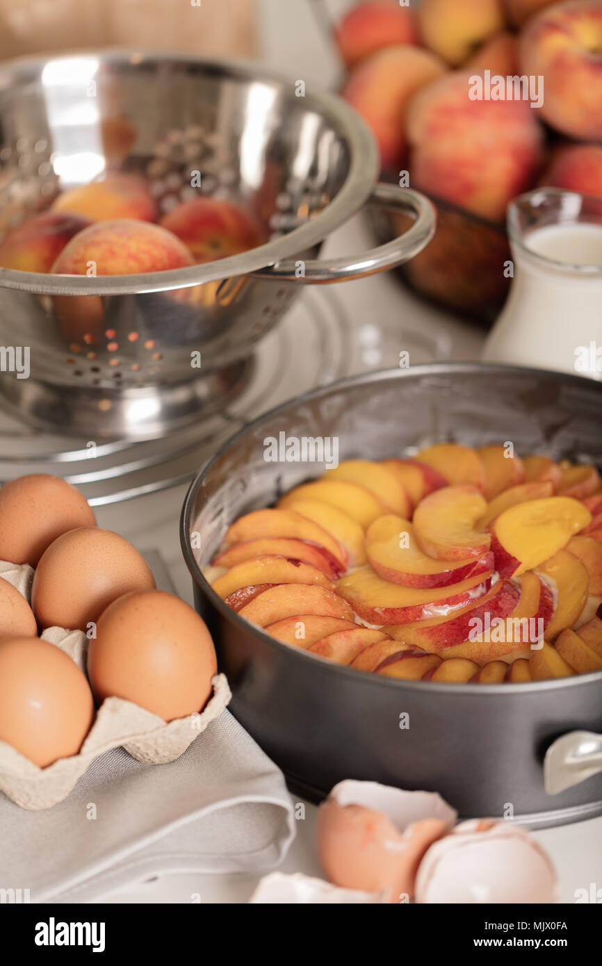 Preparation of homemade peach pie kitchen accessories and products selective focus