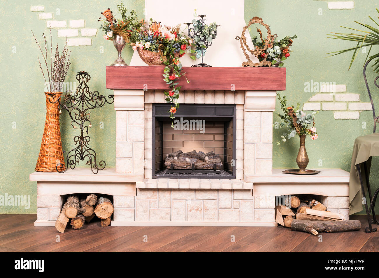 Decorative Beautiful Fireplace Without Fire With Flowers And