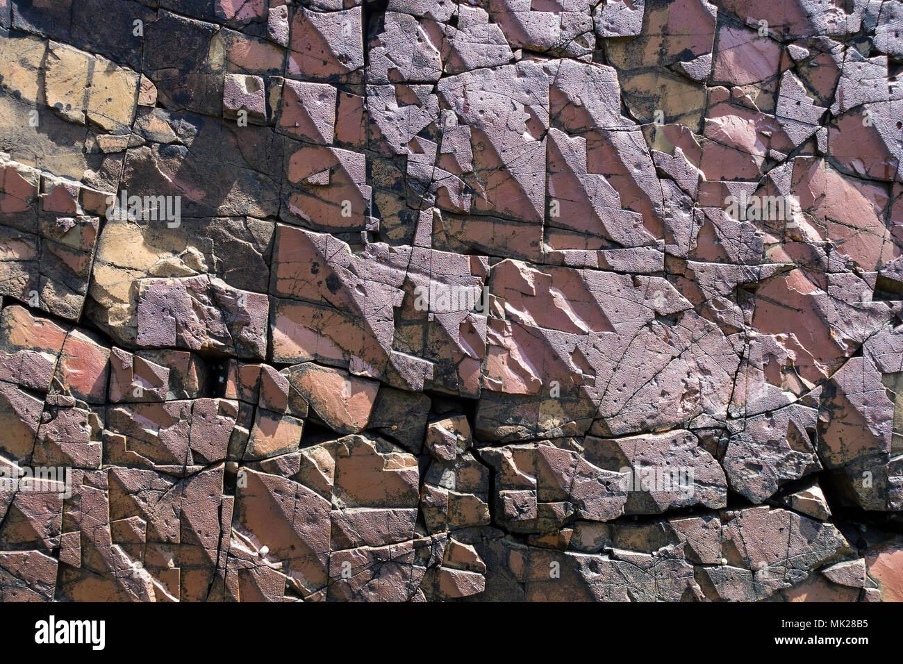 closeup-of-geometric-fractured-rock-surf