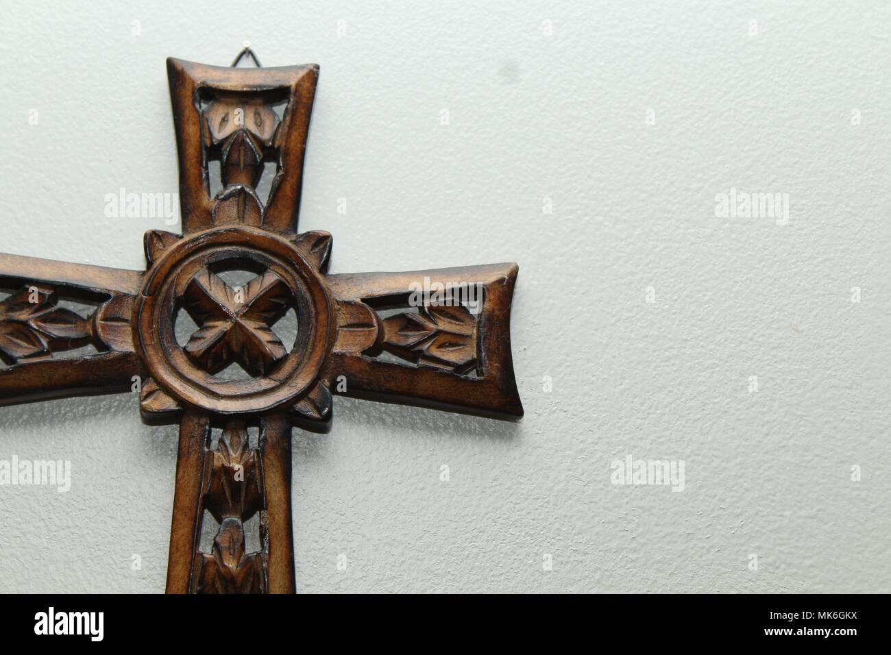 a wooden cross, Celtic style, on the left side of the frame with ...