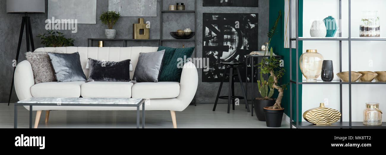 Light Grey Sofa With Decorative Pillows Placed In Industrial Living Room  Interior With Textured Wall And Decor