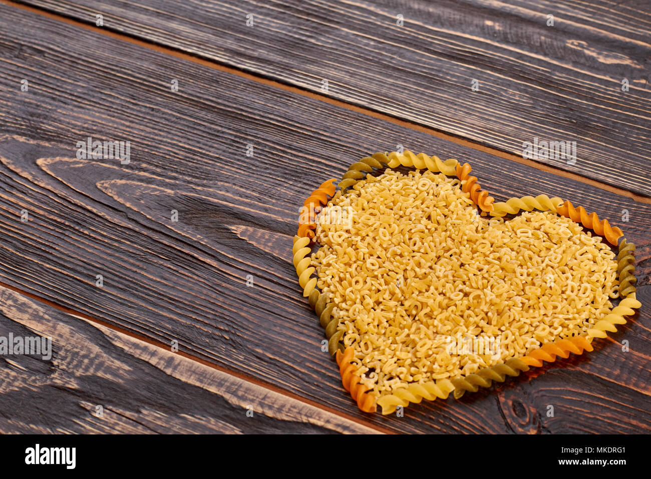 Valentines Day Background With Pasta In Heart Shape Uncooked