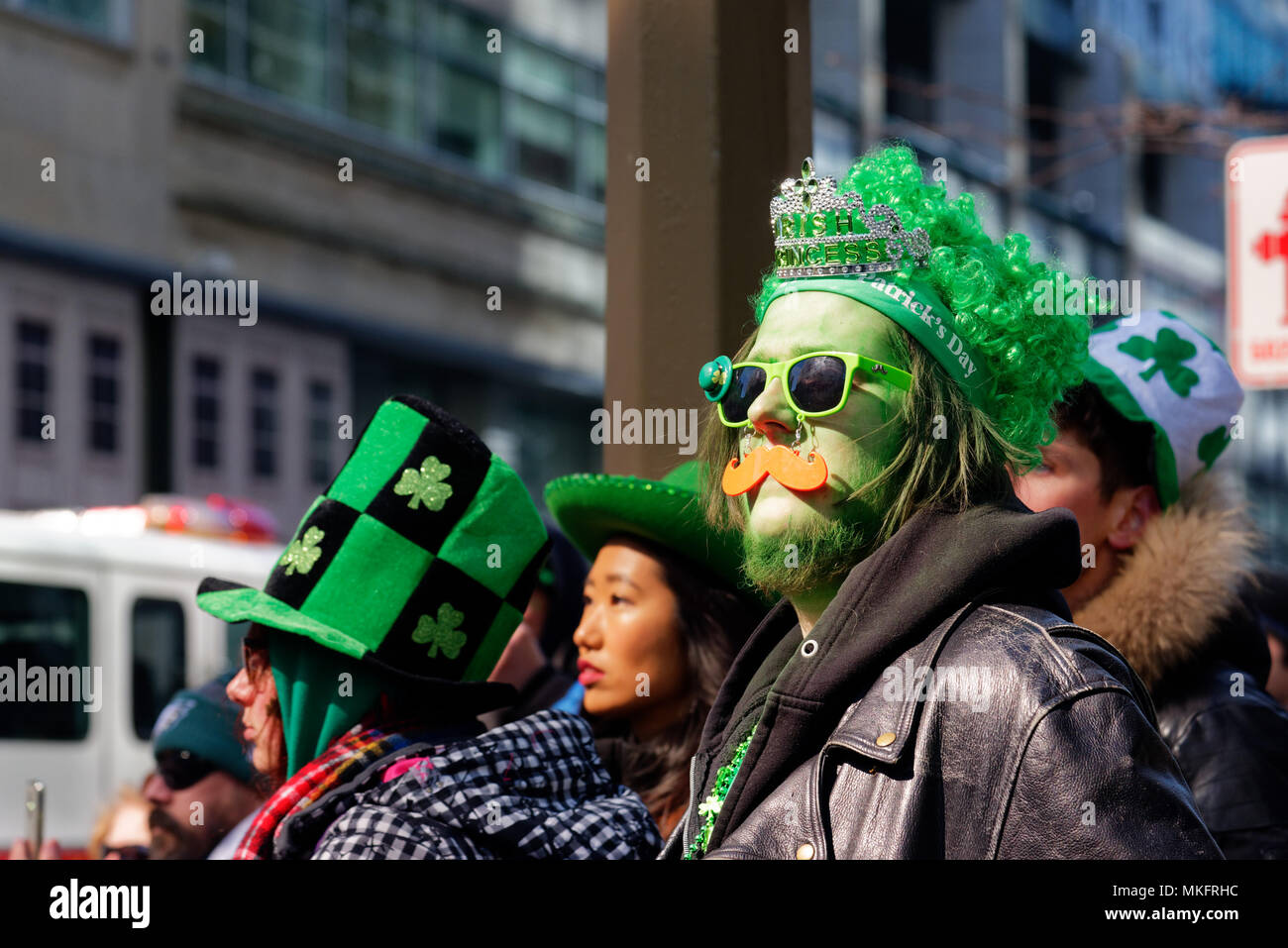 a-man-wearing-bright-green-hat-at-the-mo