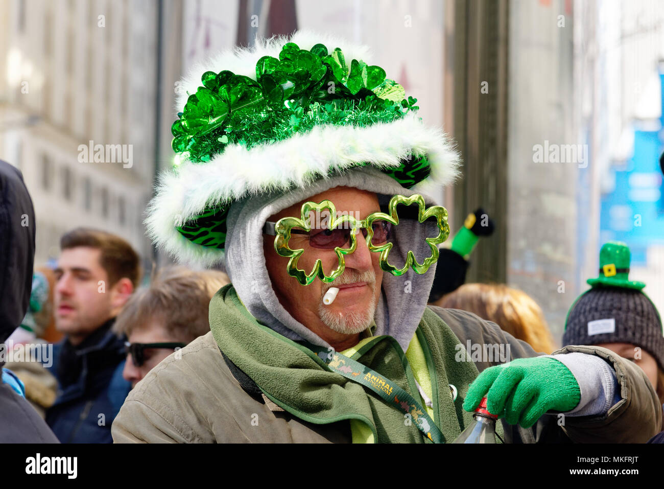 a-man-wearing-shamrock-shaped-sunglasses