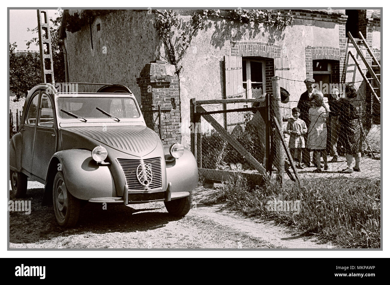 VINTAGE FRENCH AUTOMOBILE 1950's Citroën 2CV deux chevaux 1959 typical notable family French car in French rural surroundings for French press advertising - Stock Image