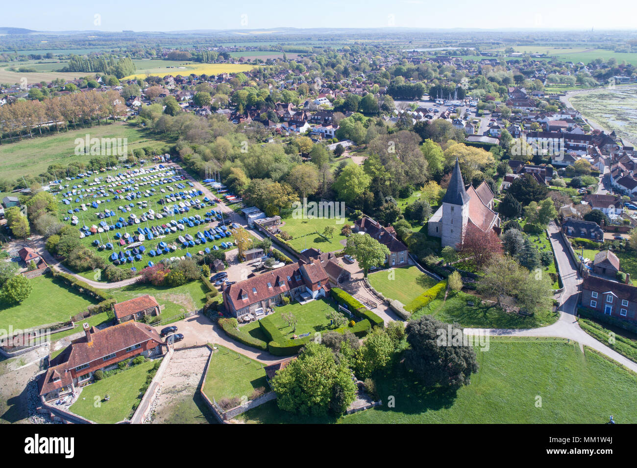 aerial views of bosham and the anglo saxon holy trinity church  in chichester harbour area of west sussex Stock Photo