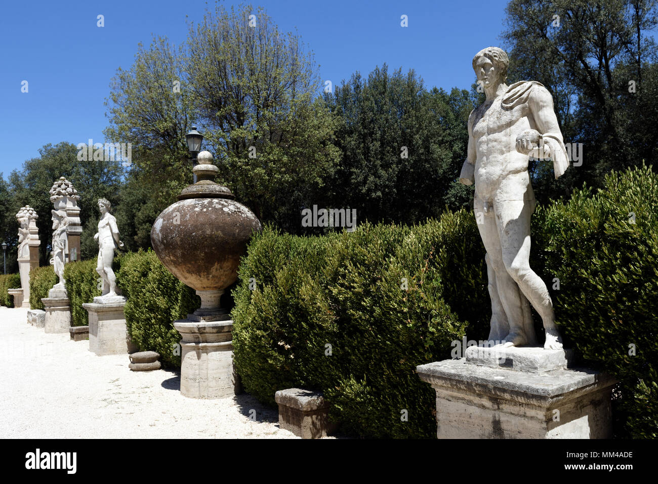 Some Of The Statues And Vases On Decorative Pedestals Decorating The Rear  Garden Of The Galleria Borghese. Rome. Italy. The 17th Century Casino Nobil
