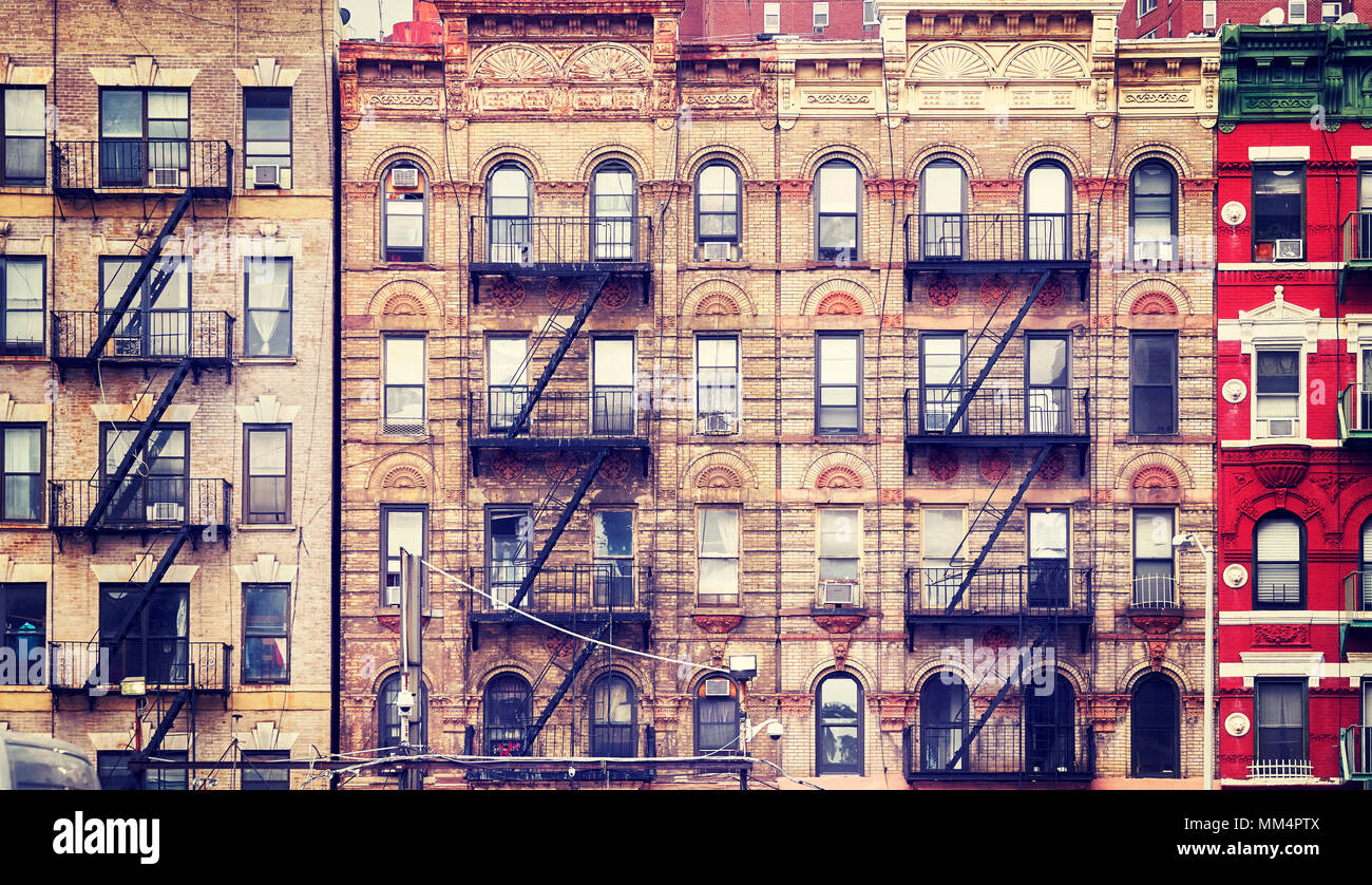 Vintage Stylized Picture Of Old Buildings With Fire Escapes One Of