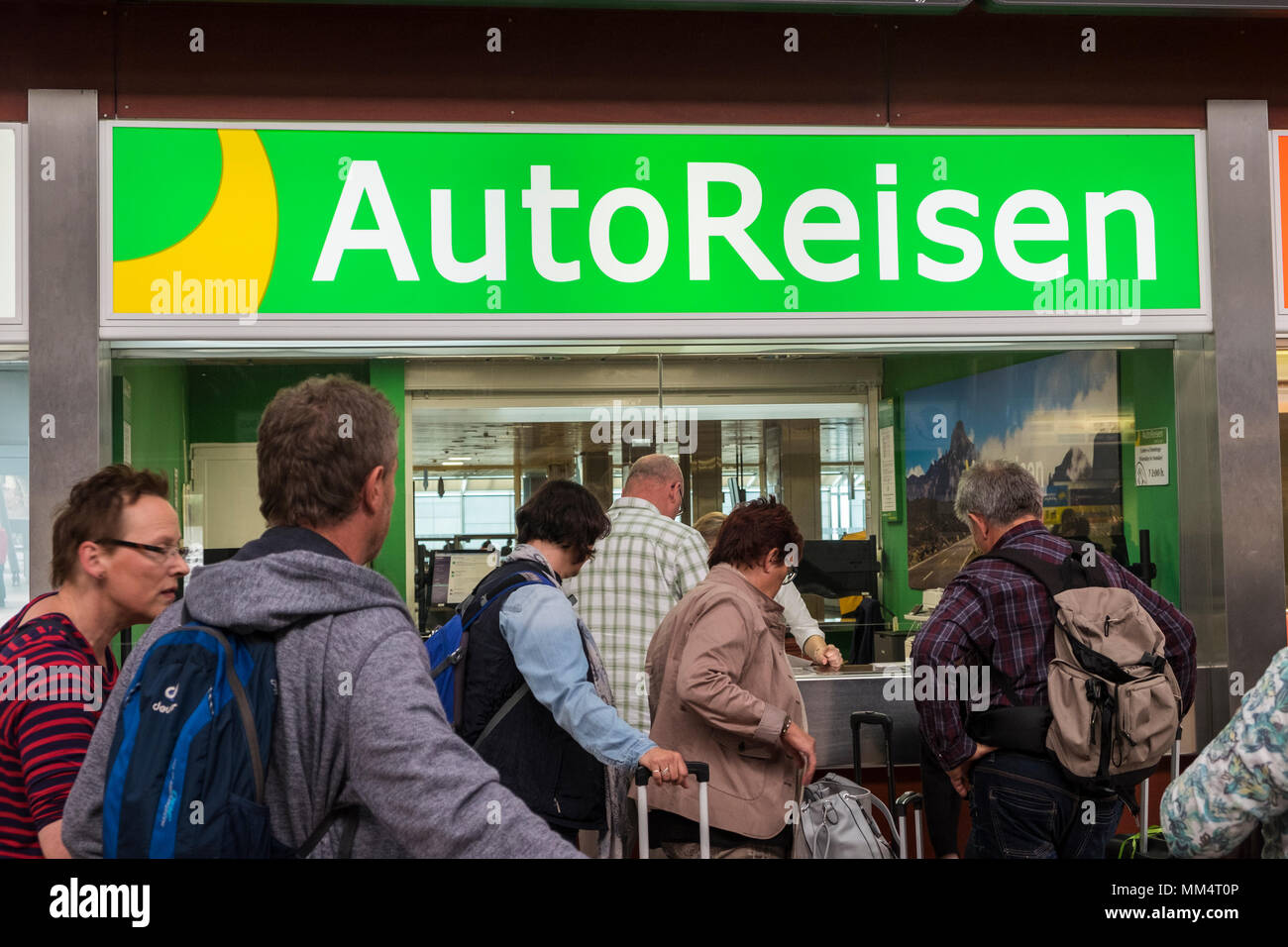 Queueing for car rental at the offices in the arrivals hall at Tenerife Sur, Reina Sofia, airport, Canary islands, Spain Stock Photo