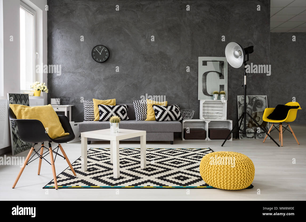 Spacious, Grey Living Room With Sofa, Chairs, Standing Lamp, Small  Coffee Table, Decorations In Yellow, Black And White