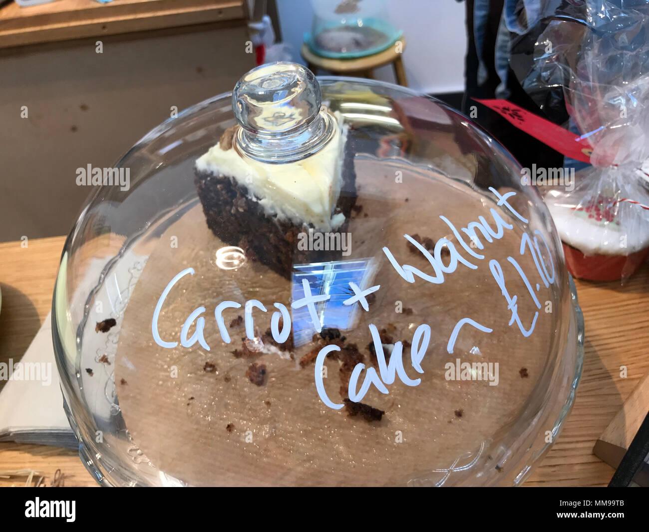 GoTonysmith,@HotpixUK,Carrot Walnut Cake,cake,counter,glass,cover,covered,for carrot + walnut cake,cake in a cafe,last slice,of cake,homemade,gluten-free,desert,sweet,treat,sin,sins,sweet sins,sugar,sugar rush,tempting cake,Sandford-on-Thames,Oxford,OX4,OX4 4YN,UK,Littlemore,Sandford Talking Shop,tasty cake,tasty,The village hall,village hall,07305307421,Henley Rd,Hemley Road