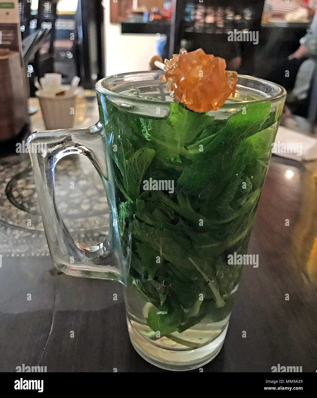 GoTonysmith,@HotpixUK,food,middle,east,eastern,cuisine,Syria,Lebanon,Sunni,Shia,cooking,restaurant,cafe,Middle eastern Mint Tea,Mint,leaves,leaf,traditional,with,Sugar,crystal,Swizzle,stick,glass,tall,tall glass,Damascena,village,Herbal Tea,Herbal,Caffeine Free,mint leaves,spearmint tea,peppermint tea,kitchen,sweet,sugar