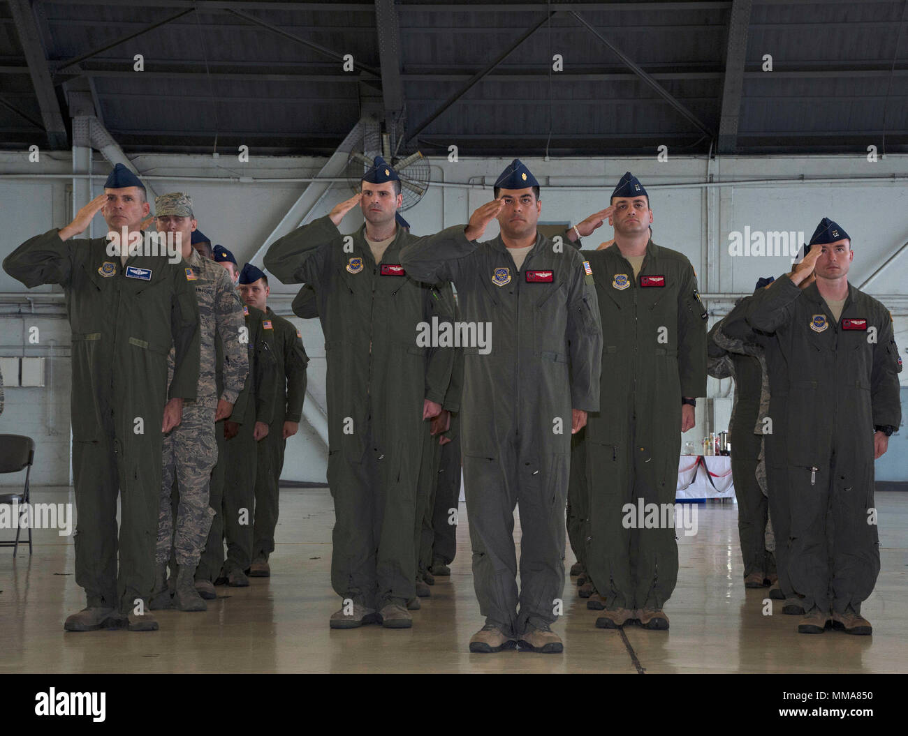 U S Air Force Airmen Salute During The Singing Of The National
