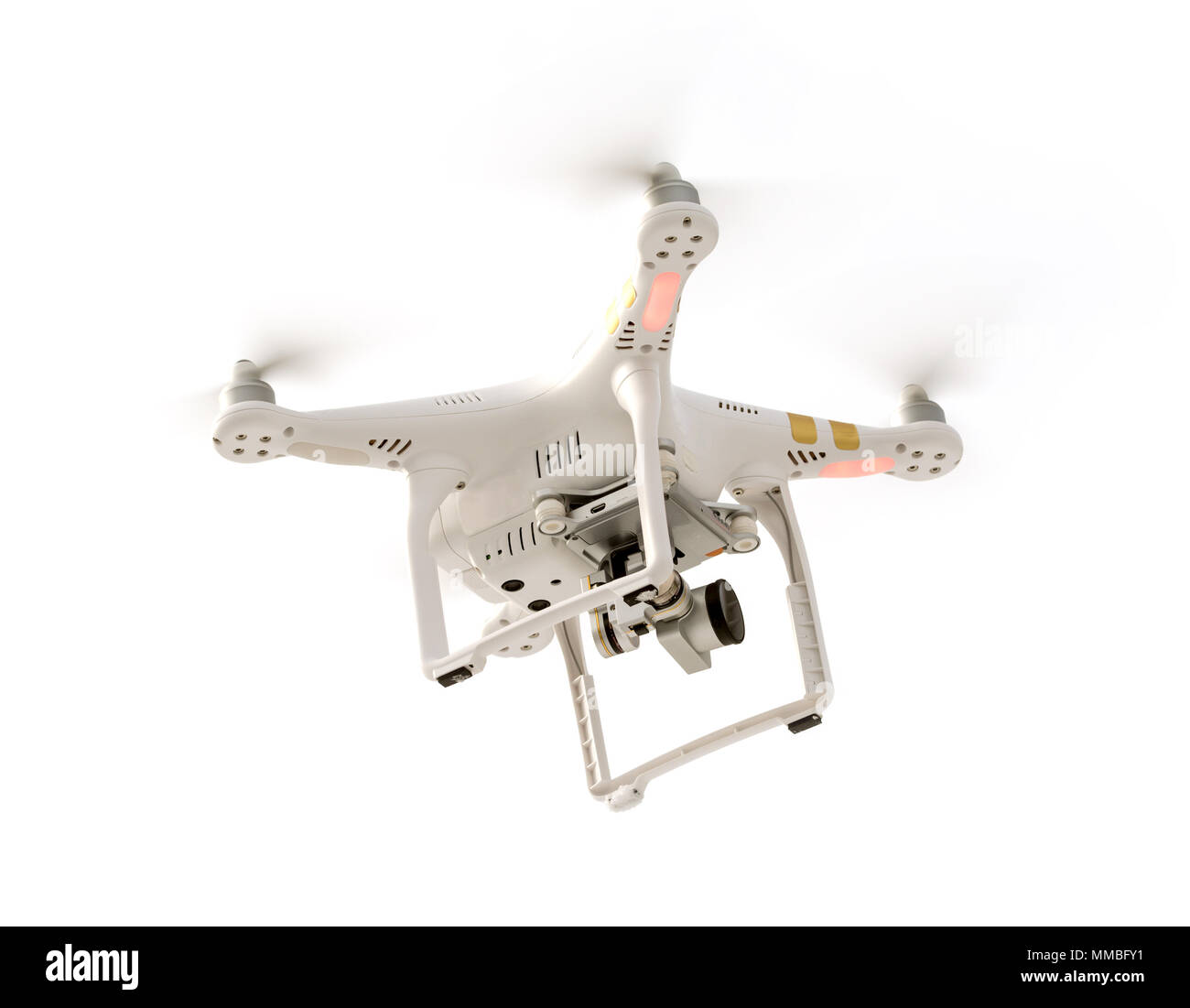 Photo of a flying camera drone isolated against a white background. Stock Photo