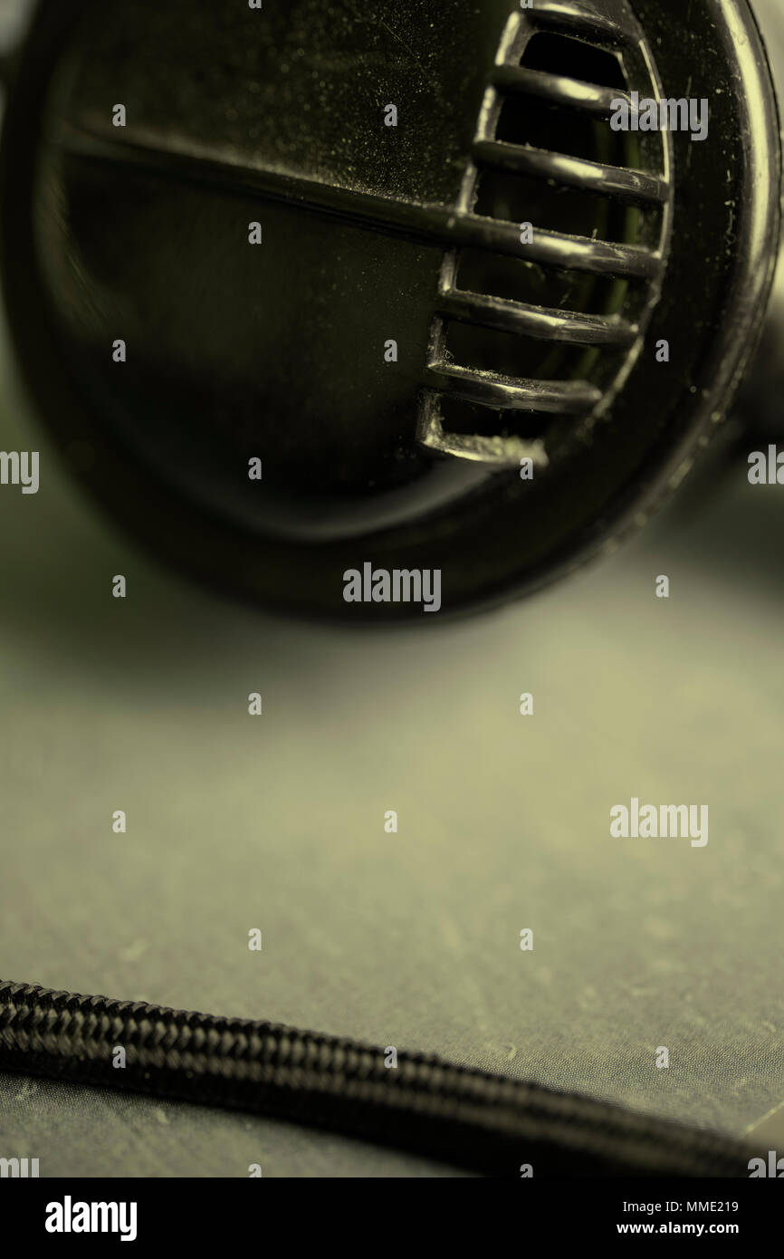 Detail of the mouth piece on the handset of a vintage black telephone - Stock Image