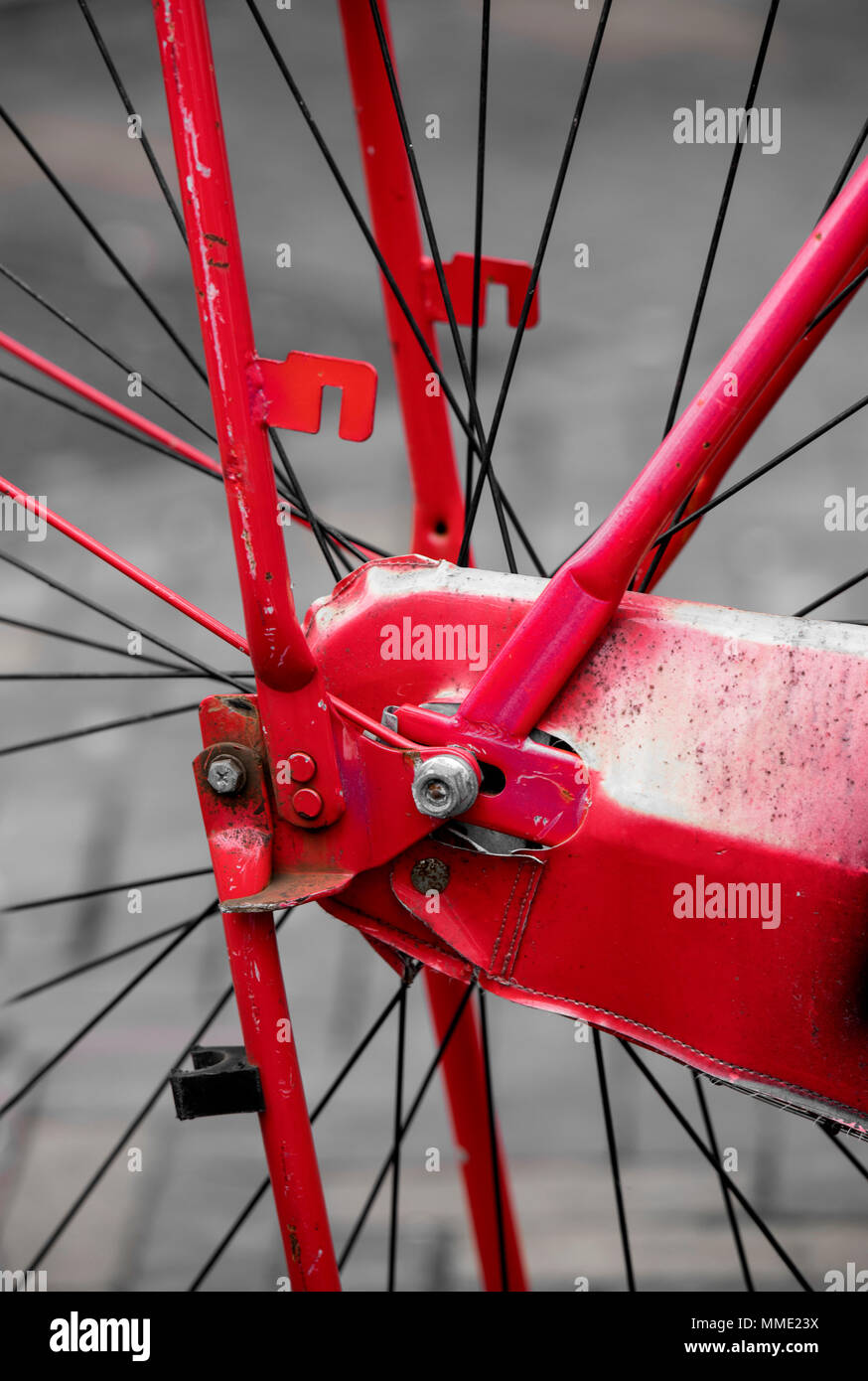 Detail of the rear wheel of a red bicycle - Stock Image