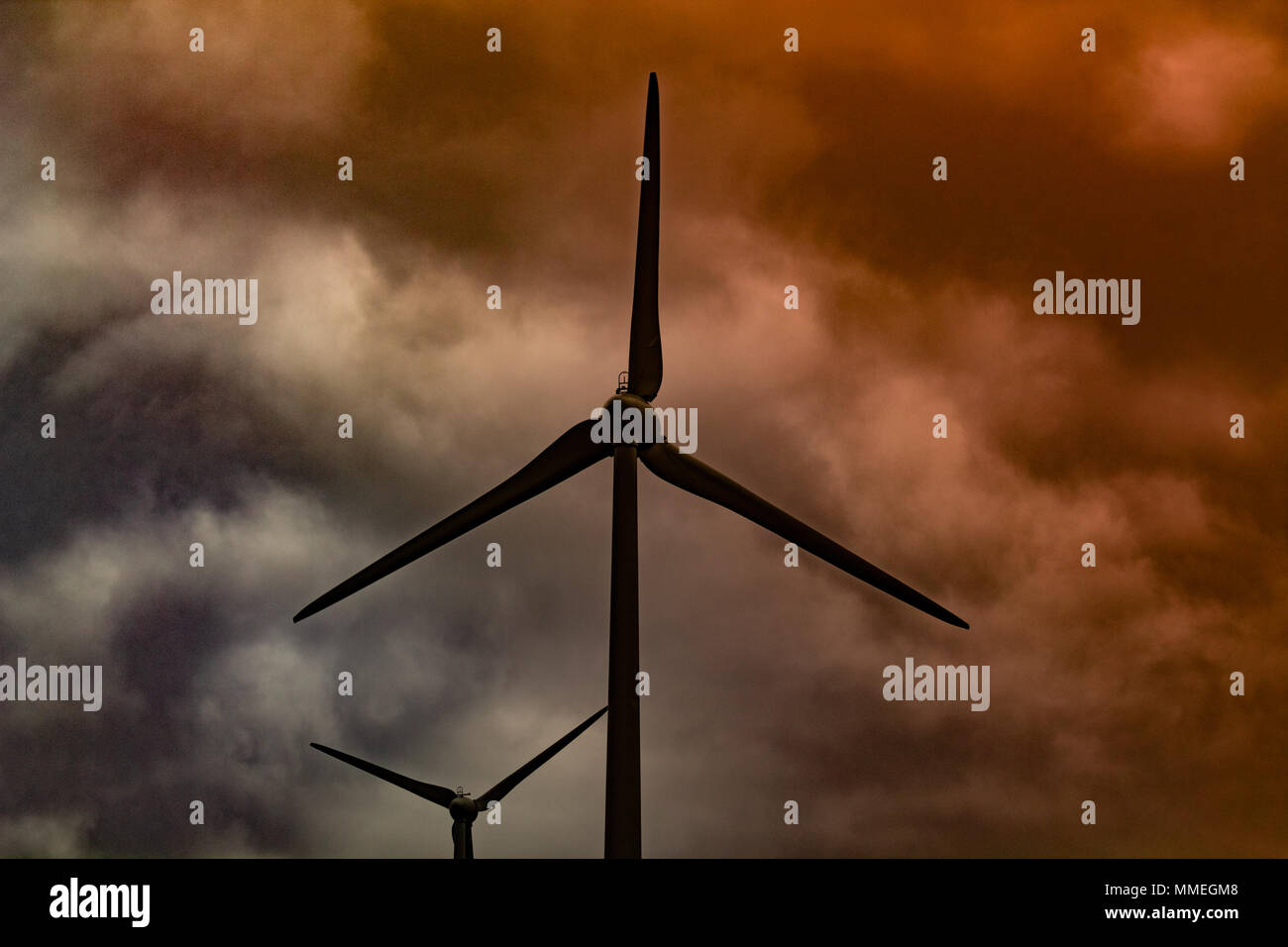 turbine blades spinning on a wind farm, windfarm on a hillside of west cork, ireland Stock Photo