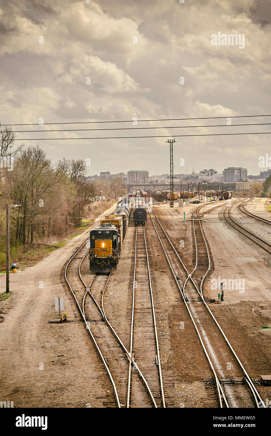 CSX Corporation train locomotive engine 4086 moving freight or rail cars in the switching yard of CSX Transportation in Montgomery Alabama, USA. - Stock Image