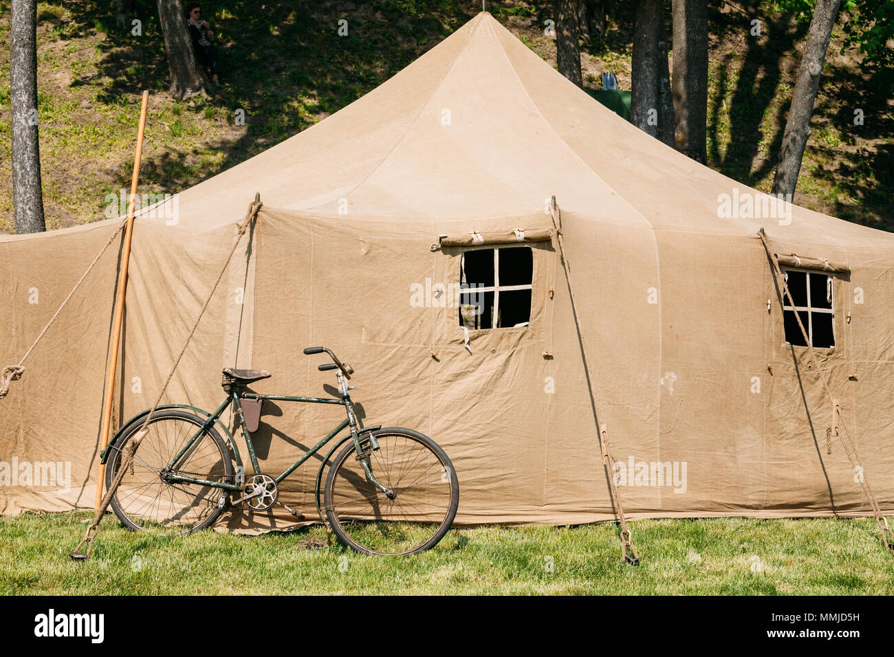 The Old Rarity Bicycle Parked Next To The Large Soviet Military Canvas Khaki Tent On Green Grass In Sunny Summer Forest. & The Old Rarity Bicycle Parked Next To The Large Soviet Military ...