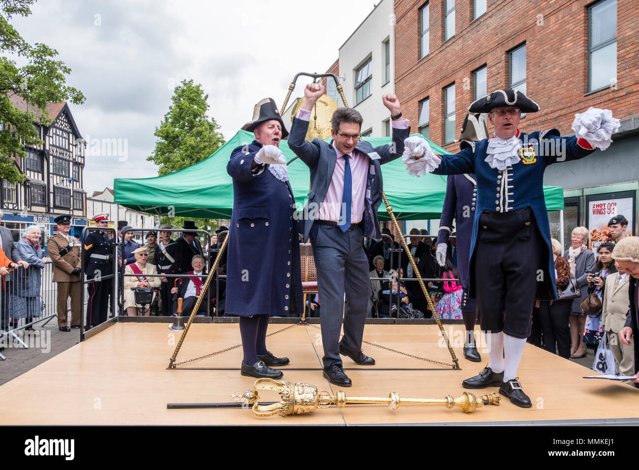 Saturday May 12th 2018. High Wycombe, Buckinghamshire, England, GB, UK. The quaint local tradition of 'Weighing in the Mayor' took place in the town centre today.  Traditionally, the outgoing and incoming mayor and civic officials are weighed at the beginning of the mayor's term of office each year to ascertain if they have gained weight at the expense of the taxpayer. The current MP for the town, Steve Baker, was adjudged to have gained weight and thus heartily booed by the crowd. Credit: D. Callcut/Alamy Live News Stock Photo