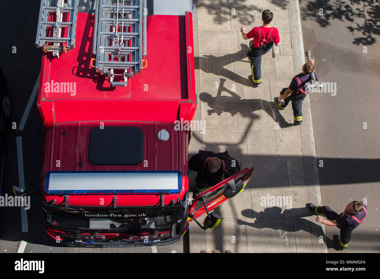 Looking down onto a fire engine attending an emergency - Stock Image