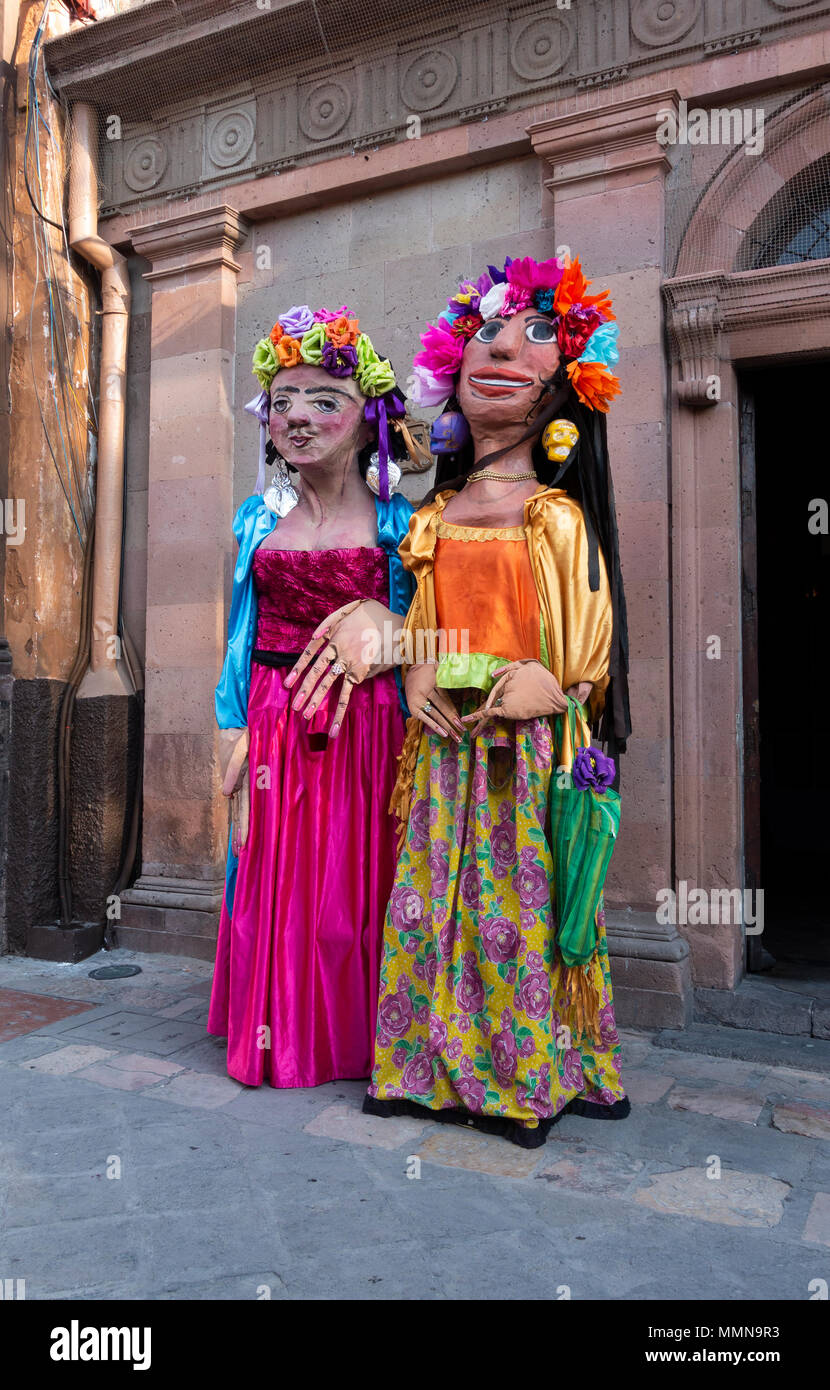 Giant puppets called mojiganas in San Miguel de Allende, Mexico - Stock Image