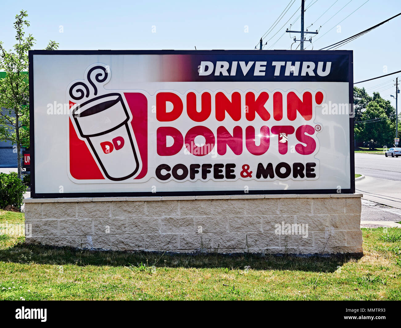 Dunkin Donuts fast food restaurant exterior sign with corporate logo. - Stock Image