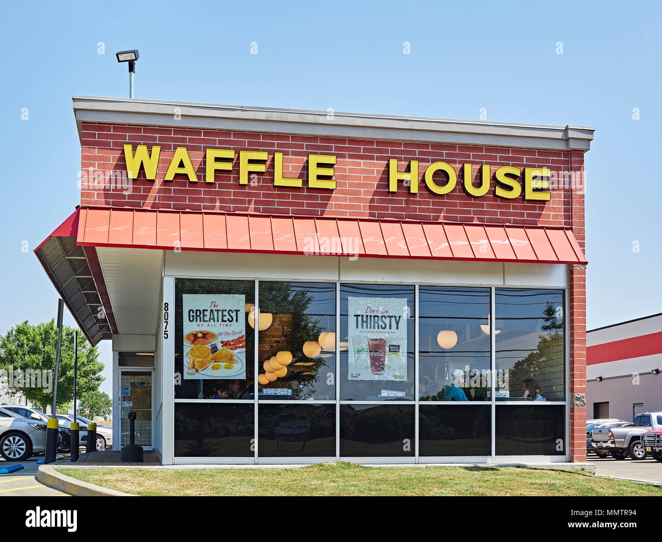 Waffle House restaurant exterior front entrance in Montgomery Alabama, USA. - Stock Image