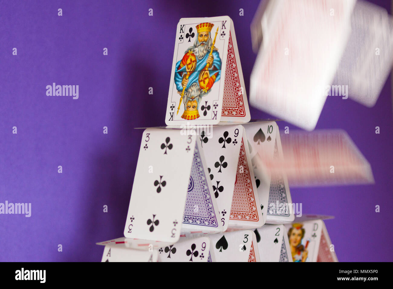 A house of cards about to collapse - a metaphor for a complicated organisation or plan that can easily go wrong Stock Photo