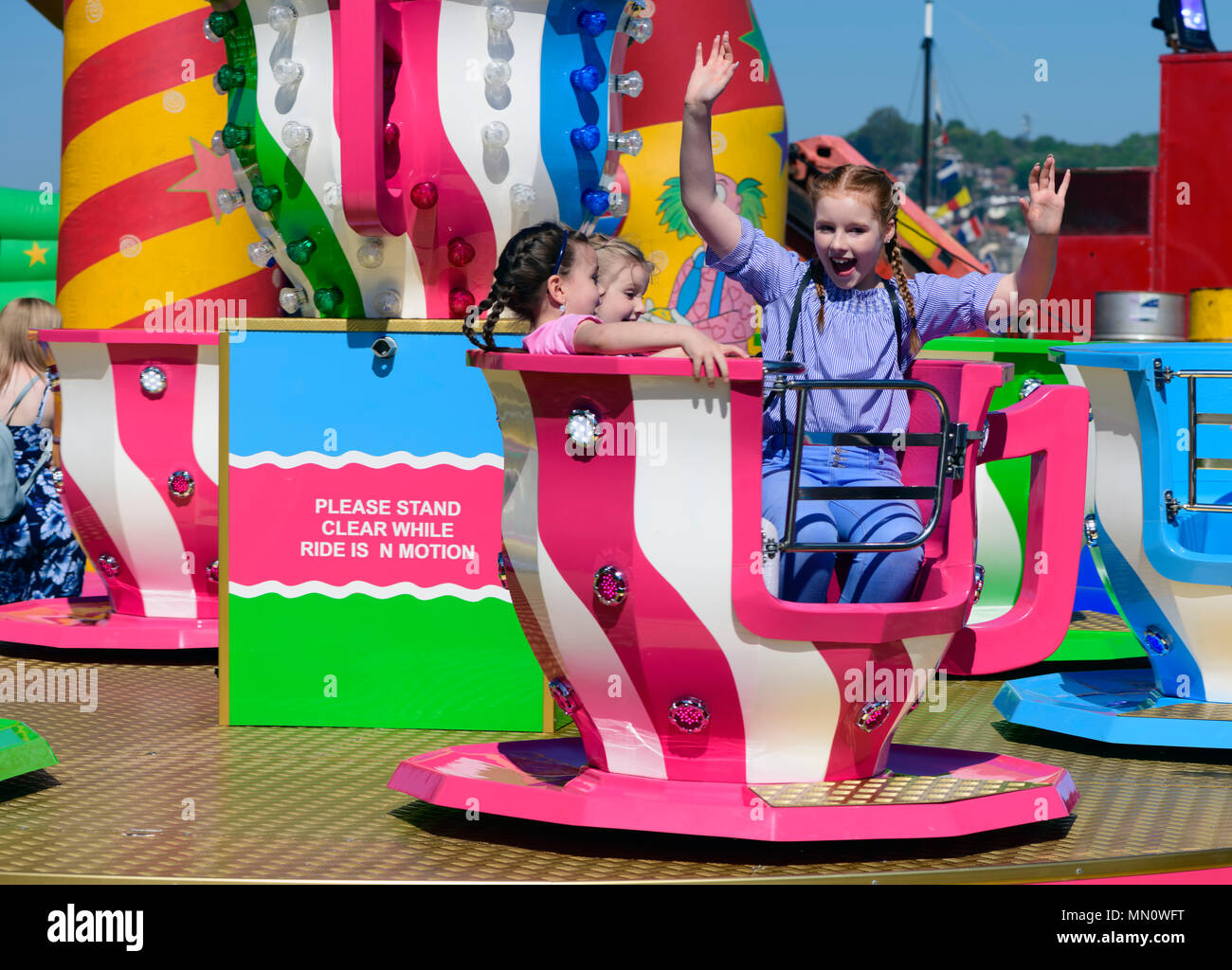 three-girls-enjoying-a-funfair-ride-MN0W