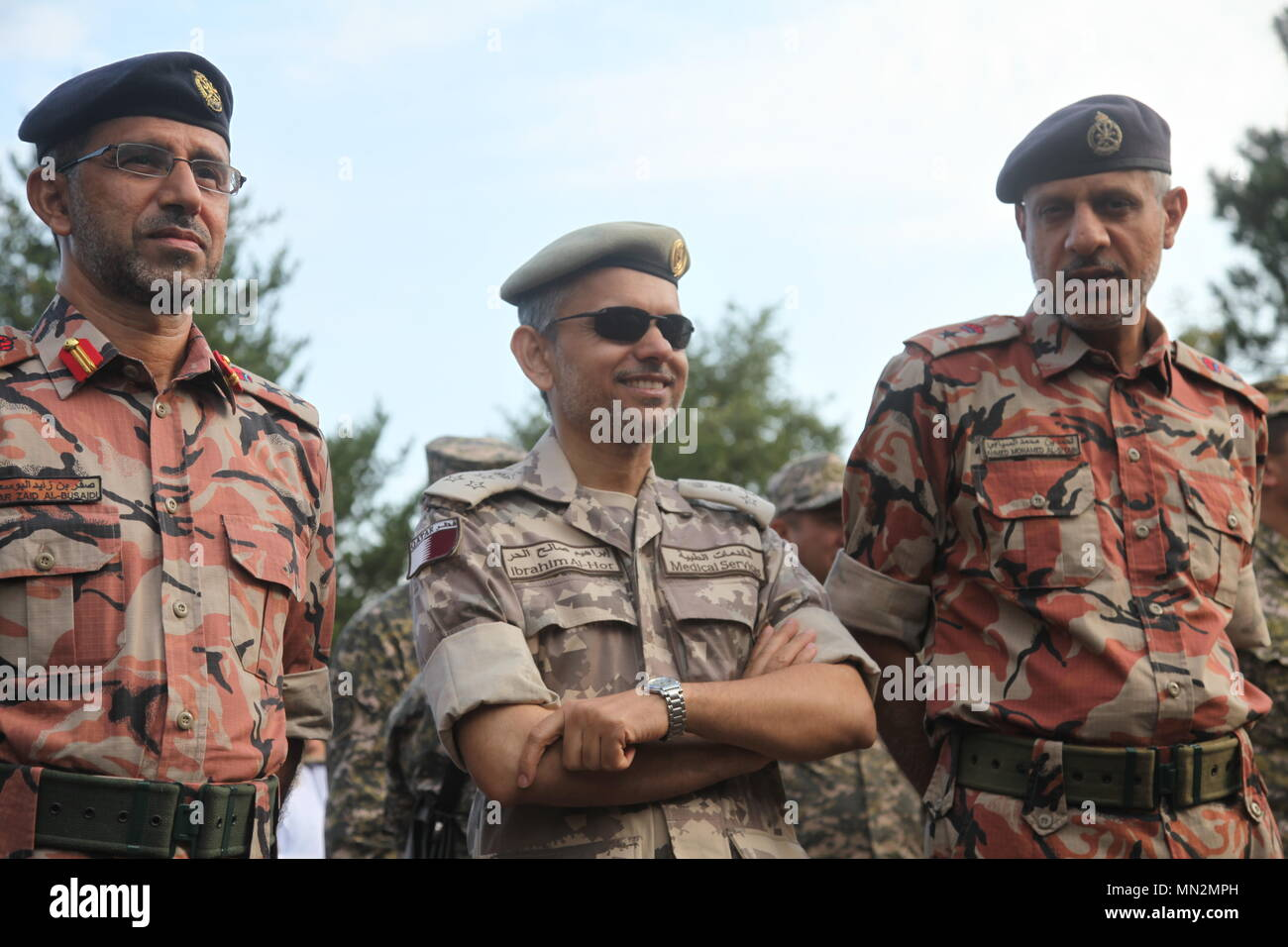 multinational armed forces officers from oman and qatar gather for a