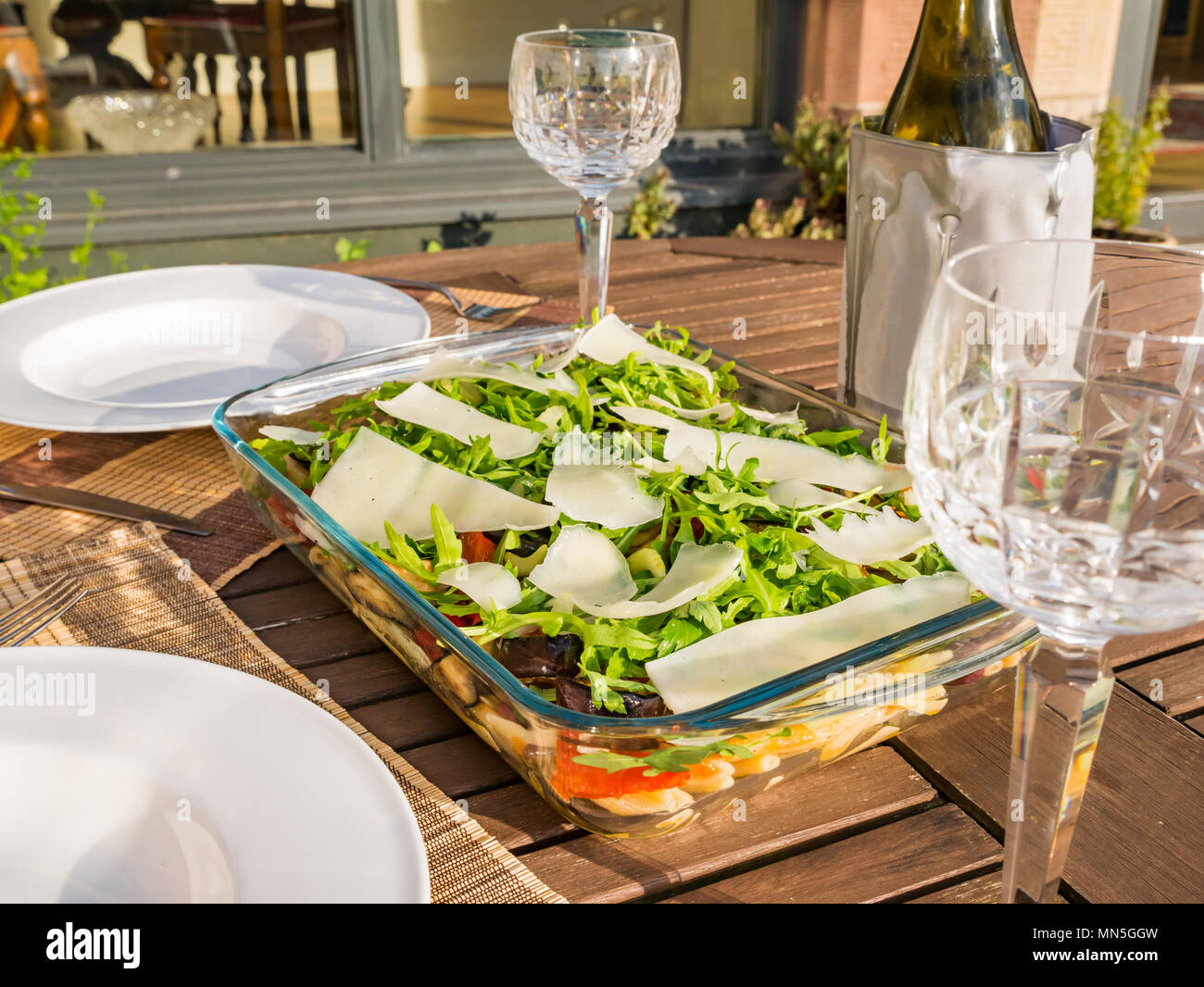 outdoor-table-in-sunshine-with-pasta-sal