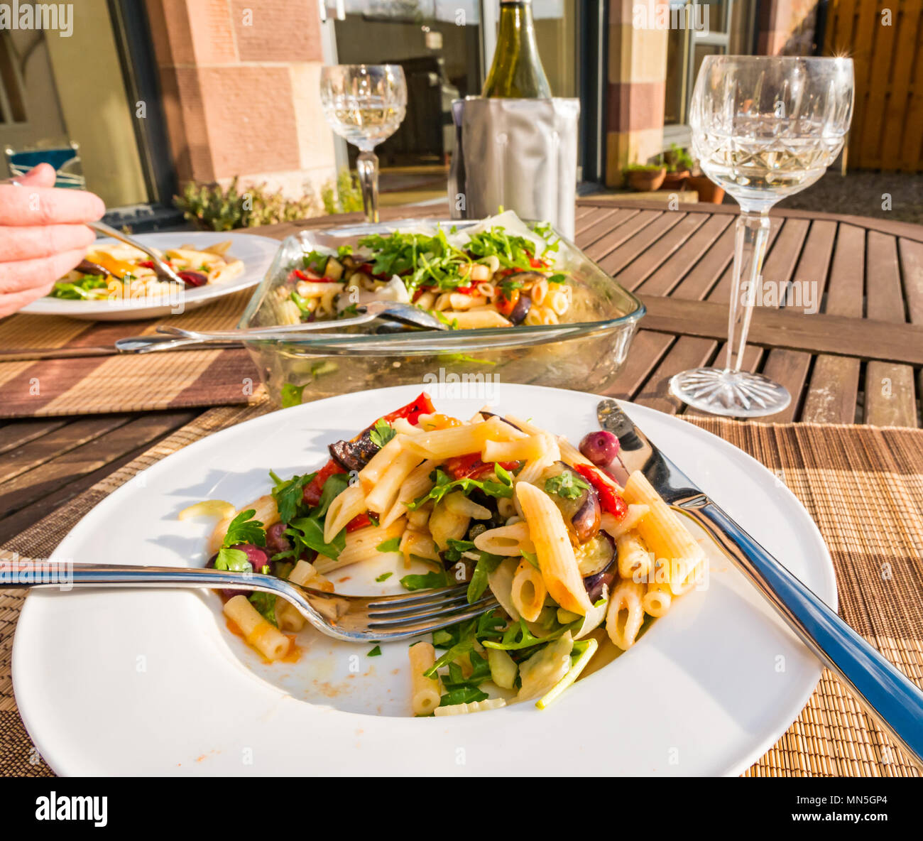 outdoor-table-with-pasta-salad-served-on