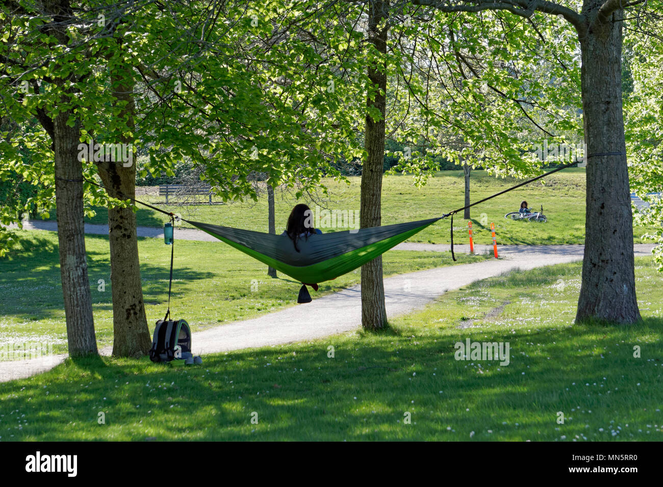 young-woman-relaxing-in-a-hammock-strung