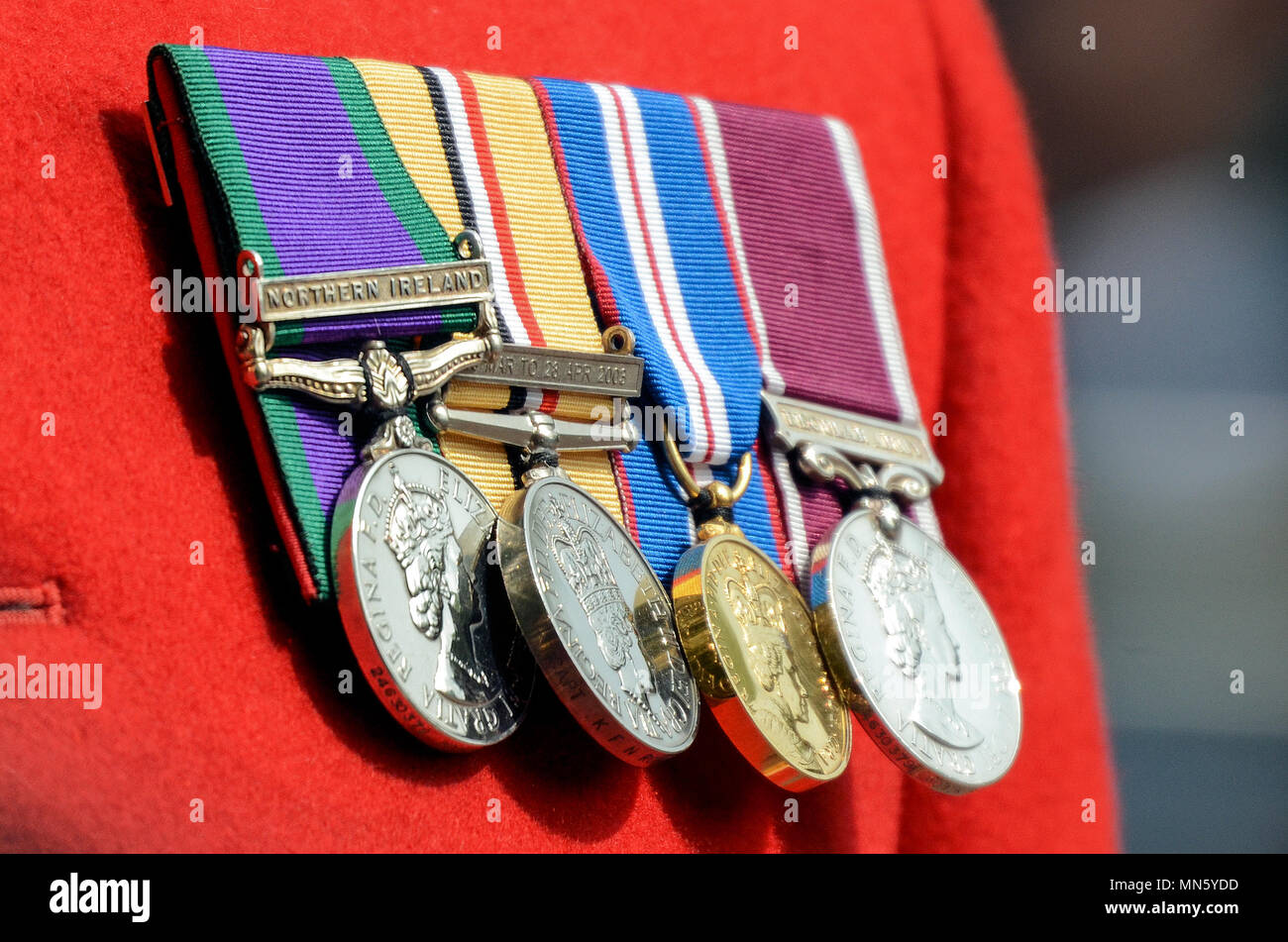 medals-on-a-soldiers-uniform-including-serving-in-northern-ireland-iraq-medal-2003-golden-jubilee-medal-long-service-and-good-conduct-lsgc-medal-MN5YDD.jpg